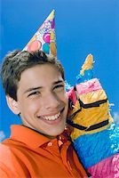 Portrait of a boy smiling with a rocking horse Stock Photo - Premium Royalty-Freenull, Code: 625-01749004