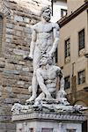 Naked statues in front of a brick wall, Hercules and Caco, Piazza della Signoria, Florence, Italy Stock Photo - Premium Royalty-Freenull, Code: 625-01751354