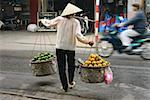Rear view of a woman selling fruits, Hanoi, Vietnam Stock Photo - Premium Royalty-Free, Artist: Robert Harding Images, Code: 625-01753071