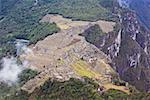 High angle view of ruins on mountains, Mt Huayna Picchu, Machu Picchu, Cusco Region, Peru