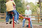 Woman on Teeter-Totter with Grandsons    Stock Photo - Premium Rights-Managed, Artist: Kevin Dodge, Code: 700-01753617