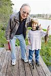 Boy Fishing with Grandfather    Stock Photo - Premium Rights-Managed, Artist: Kevin Dodge, Code: 700-01753623