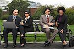 Business People on Park Bench, New York City, New York, USA
