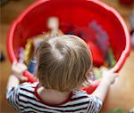 Boy with Bucket of Toys    Stock Photo - Premium Rights-Managed, Artist: Derek Shapton, Code: 700-01764341