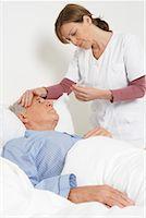 Nurse Taking Patient's Temperature    Stock Photo - Premium Rights-Managednull, Code: 700-01764482