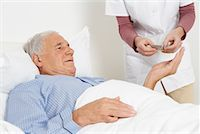 Nurse Giving Medication to Patient    Stock Photo - Premium Rights-Managednull, Code: 700-01764484