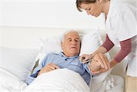 Nurse Checking Patient's Blood Pressure Stock Photo - Premium Rights-Managednull, Code: 700-01764487