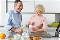 Couple with Breakfast in Kitchen    Stock Photo - Premium Royalty-Freenull, Code: 600-01764535