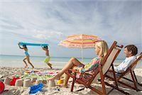 family active beach - Parents Watching Children Play on Beach, Majorca, Spain    Stock Photo - Premium Royalty-Freenull, Code: 600-01764738