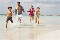 Family Running along Beach, Majorca, Spain    Stock Photo - Premium Royalty-Freenull, Code: 600-01764752