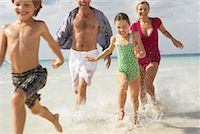 Family Running along Beach, Majorca, Spain    Stock Photo - Premium Royalty-Freenull, Code: 600-01764753