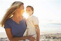 Mother Holding Daughter on Beach, Majorca, Spain    Stock Photo - Premium Royalty-Freenull, Code: 600-01764773