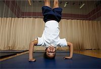 Girl Doing a Headstand    Stock Photo - Premium Royalty-Freenull, Code: 600-01764806
