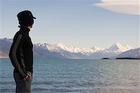 snow capped - Man Looking over Lake and Mountains, Lake Pukaki, Mount Cook, Canterbury, New Zealand    Stock Photo - Premium Rights-Managednull, Code: 700-01765146