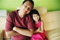 Father with one child, arms crossed Stock Photo - Premium Royalty-Freenull, Code: 656-01769511