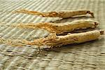 Still life of dried ginseng Stock Photo - Premium Royalty-Free, Artist: Asia Images, Code: 656-01772064