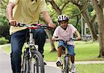 A father and son ride their bikes together Stock Photo - Premium Royalty-Free, Artist: AlaskaStock              , Code: 655-01781425