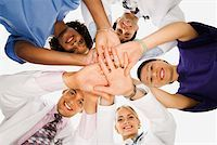 Huddled healthcare workers Stock Photo - Premium Royalty-Freenull, Code: 604-01786087