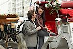 Couple Entering Horse-Drawn Carriage, New York City, New York, USA    Stock Photo - Premium Royalty-Free, Artist: Masterfile, Code: 600-01787359