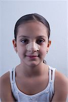 preteen  smile  one  alone - Portrait of Girl With Bandaged Nose    Stock Photo - Premium Rights-Managednull, Code: 700-01788299