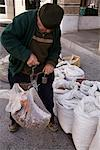 Man Weighing Bag of Chestnuts, Puebla de Sanabria, Zamora, Spain    Stock Photo - Premium Rights-Managed, Artist: Mike Randolph, Code: 700-01788746