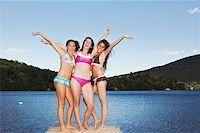 Teen girls in bikinis posing Stock Photo - Premium Royalty-Freenull, Code: 621-01799871