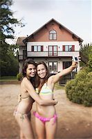 Teenage girls taking a picture Stock Photo - Premium Royalty-Freenull, Code: 621-01799914