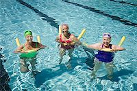 seniors and swim cap - Senior woman swimmers in pool with flotation devices Stock Photo - Premium Royalty-Freenull, Code: 621-01800094