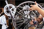 A factory worker checking a bicycle wheel Stock Photo - Premium Royalty-Freenull, Code: 614-01819258