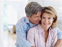 Couple in kitchen being affectionate Stock Photo - Premium Royalty-Freenull, Code: 635-01823822