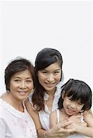 Two women and young girl indoors bonding Stock Photo - Premium Royalty-Freenull, Code: 635-01824049