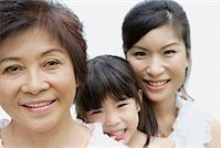 Two women and young girl indoors bonding Stock Photo - Premium Royalty-Freenull, Code: 635-01824052