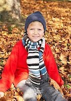 Young boy outdoors looking at camera Stock Photo - Premium Royalty-Freenull, Code: 635-01824894