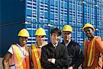 Businessman and workers with shipping containers Stock Photo - Premium Royalty-Free, Artist: Matthias Tunger, Code: 604-01826771