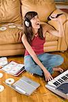 Woman recording music on laptop computer Stock Photo - Premium Royalty-Free, Artist: David Muir, Code: 604-01826892