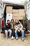 Family Sitting on Back of Moving Van    Stock Photo - Premium Royalty-Free, Artist: Masterfile, Code: 600-01827083