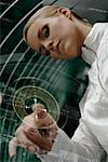 Futuristic Woman Activating Touchscreen    Stock Photo - Premium Rights-Managed, Artist: Trojer, Code: 700-01827283