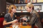 Couple with Cell Phones in Cafe    Stock Photo - Premium Royalty-Free, Artist: Masterfile, Code: 600-01827683