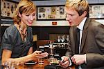 Couple with Cell Phones in Cafe    Stock Photo - Premium Royalty-Free, Artist: Masterfile, Code: 600-01827684