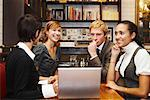 Businesspeople with Laptop in Cafe    Stock Photo - Premium Royalty-Free, Artist: Masterfile, Code: 600-01827687