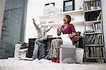 Woman and Boy Playing with Shredded Paper in Office    Stock Photo - Premium Rights-Managed, Artist: Masterfile, Code: 700-01827609