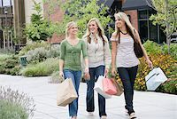 Three teenage girls (16-17) shopping together at mall Stock Photo - Premium Royalty-Freenull, Code: 613-01829529