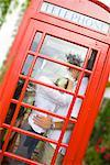 Couple Kissing in Phone Booth, Newport Beach, Orange County, California, USA