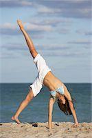 Girl Doing Cartwheel on Beach    Stock Photo - Premium Royalty-Freenull, Code: 600-01838205