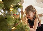 Girl Sitting by Christmas Tree