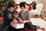 Parents and Daughter Wrapping Christmas Presents