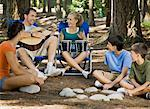 Family playing instruments at campsite Stock Photo - Premium Royalty-Free, Artist: Westend61                , Code: 621-01839466