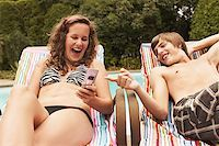 Teenage couple with cell phone Stock Photo - Premium Royalty-Freenull, Code: 621-01839501
