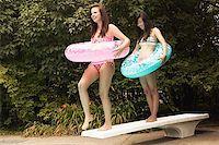 Teenage girls with swim rings Stock Photo - Premium Royalty-Freenull, Code: 621-01839512