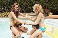 Teenagers playing in pool Stock Photo - Premium Royalty-Freenull, Code: 621-01839521
